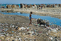 A Haitian girl plays in a garbage dump surrounding shacks in the slum of Cité Soleil, Port-au-Prince, Haiti, 11 July 2008. Cité Soleil is considered one of the worst slums in the Americas, most of its 300.000 residents live in extreme poverty. Children and single mothers predominate in the population. Social and living conditions in the slum are a human tragedy. There is no running water, no sewers and no electricity. Public services virtually do not exist - there are no stores, no hospitals or schools, no urban infrastructure. In spite of this fact, a rent must be payed even in all shacks made from rusty metal sheets. Infectious diseases are widely spread as garbage disposal does not exist in Cité Soleil. Violence is common, armed gangs operate throughout the slum.