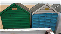 BNPS.co.uk (01202 558833)<br /> Pic: RichardCrease/BNPS<br /> <br /> Gillian Vincent struggles to see the sea.<br /> <br /> Beach hut owners fury after sea views are blocked...by more beach huts.<br /> <br /> Irate beach hut owners have slammed a council who have allowing a row of beach huts to be built directly in front of them blocking their beautiful sea views.<br /> <br /> Owners who pay &pound;1,094 a year to the council to have a beach hut there will instead have to make do with the view of the back of another beach hut.<br /> <br /> Furious owners in the Manor Steps area in Bournemouth, Dorset, are demanding action after being told of plans to place more huts between them and the beach by the end of the month.<br /> <br /> They claim their views of the sea, beach and prom will be completely blocked and that the council has not consulted them on the plans.<br /> <br /> Bournemouth Borough Council said the move is necessary to allow for the creation of a turning circle for the newly-routed land train.<br /> <br /> Mrs Vincent, who has owned a beach hut for more than 50 years, said: &quot;What's the point of owning a beach hut if all you can see is the back of another hut?