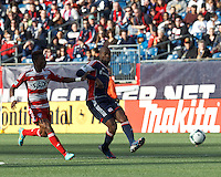 New England Revolution defender Jose Goncalves (23) under pressure passes the ball. .  In a Major League Soccer (MLS) match, FC Dallas (red) defeated the New England Revolution (blue), 1-0, at Gillette Stadium on March 30, 2013.
