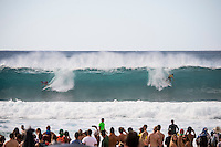 Pipeline, North Shore of Oahu, Hawaii Friday December 19 2014) Julian Wilson (AUS) splits the peak at Pipeline with Gabriel Medina (BRA) in the first wave of the final..- The final stop of the 2014  World Championship Tour, the Billabong Pipe Masters in Memory of Andy Irons, was  ccompleted today in NW double overhead surf. <br /> Gabriel Medina (BRA) became the first ever Brazilian World Champion after both rival contenders , Kelly Slater (USA) and Mick Fanning (AUS) were eliminated from the contest. Medina went onto finish 2nd overall behind Julian Wilson (AUS). <br /> In the overlapping heat format Wilson surf three consequent heats and still had enough entry to take out the 30 minute final.<br /> By winning the final Wilson also won the covered Vans Triple Crown of Surfing for best overall performance through the whole Triple Crown.<br /> <br /> The Billabong Pipe Masters in Memory of Andy Irons will determine this year&rsquo;s world surfing champion as well as those who qualify for the elite tour in 2015. As the third and final stop on the Vans Triple Crown of Surfing Series  the event will also determine the winner of the revered three-event leg.<br /> <br />  Photo: joliphotos.com