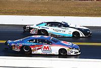 Mar 19, 2017; Gainesville , FL, USA; NHRA pro stock driver Allen Johnson (near) races alongside Shane Gray during the Gatornationals at Gainesville Raceway. Mandatory Credit: Mark J. Rebilas-USA TODAY Sports