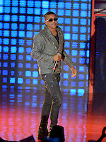 MIAMI, FL - OCTOBER 29: Randy Malcom Martinez of Gente de Zona performs at the Jennifer Lopez Gets Loud for Hillary Clinton at GOTV Concert in Miami at Bayfront Park Amphitheatre on October 29, 2016 in Miami, Florida. Credit: MPI10 / MediaPunch