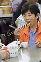 China, Hong Kong S.A.R..Dim Sum at Lin Heung Tea House, a traditional dim sum restaurant.