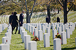 ARLINGTON, VA - NOVEMBER 11: U.S. President Barack Obama and first lady Michelle walk through Arlington National Cemetery after greeting family members of fallen service men and women on Veteran's Day November 11, 2012 in Arlington, Virginia.