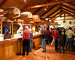 Visitors to Barboursville Vineyards move through the tasting room from window to window.  Each window pours samples of different wines.