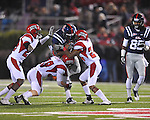 Ole Miss running back Enrique Davis (27) is tackled by Louisiana-Lafayette's Lionel Stokes (24) , Louisiana-Lafayette's Melvin White (22) in Oxford, Miss. on Saturday, November 6, 2010. Ole Miss won 43-21.