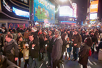 "Thousands upon thousands of tourists pack Times Square on Friday, December 30, 2011, the night before New Year's Eve. Mild weather predicted for New Year's Eve is expected to bring well over a million people to pack the ""Crossroads of the World"" celebrating the incoming 2012. (© Richard B. Levine)"