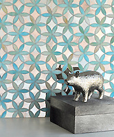 Fiona, a handmade mosaic shown in Aquamarine jewel glass and Dawn mirror, is part of the Silk Road Collection by Sara Baldwin for New Ravenna.<br />