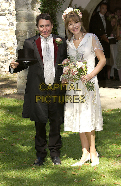 Wedding marraige wife husband white dress bouquet flowersblack tie