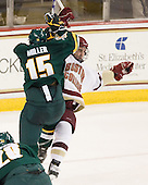 Kevan Miller (Vermont - 15), Chris Kreider (BC - 19) - The Boston College Eagles defeated the visiting University of Vermont Catamounts 6-0 on Sunday, November 28, 2010, at Conte Forum in Chestnut Hill, Massachusetts.