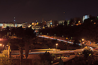 Night traffic on Derech Hevron and Hativat Yerushalayim passes the Sultan's Pool on the way to the Jaffa Gate in Jerusalem's Old City.