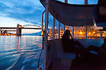 The view of the Burrard Street Bridge as seen at dusk from a water taxi in False Creek, downtown Vancouver, B.C.