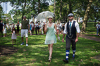 Participants dress up in costume for the 8th Bi-Annual Jazz Age Lawn Party on Governor's Island in New York on Saturday, August 17, 2013. The event, organized by Michael Arenella and his Dreamland Orchestra, attracts hundreds of people costumed in their finest prohibition era clothing.  (© Frances M. Roberts)