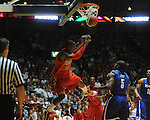 Mississippi's Murphy Holloway (31) dunks over Memphis' Willie Kemp (5) in Oxford, Miss. on Friday, March 19, 2010. Ole Miss won 90-81.