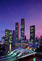 Skyline view of the Singapore harbor, bridge and skyscrapers at twilight. Singapore