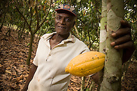 Cocoa farmer Lawson Lanquaye Mensah, 70, stands in a cocoa plantation on his farm in the town of Assin Adadientem, roughly 100km west of Ghana's capital Accra on Sat. January 21, 2007.