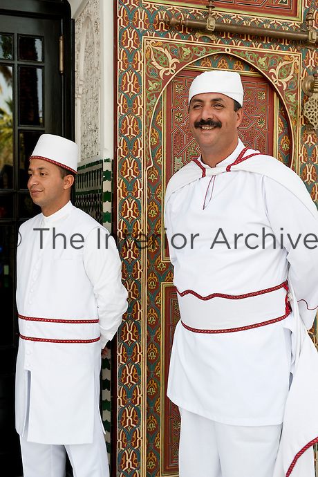 Doormen ready to welcome guest at the entrance of the Hotel La Mamounia