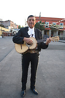 A mariachi musician waits for the night to begin in Plaza Garibaldi where Mariachis gather to be hired in Mexico City, Friday, Jan. 4, 2008