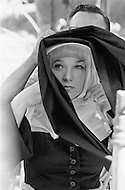 """Mexico, 1969. Actress Shirley MacLaine wearing a nun's costume on the movie set of the American 1970 western film """"Two Mules for Sister Sara"""" directed by Don Siegel. Actor Clint Eastwood starred as the cowboy Hogan and Maclaine starred as Sister Sara in the comedy."""