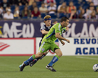 Seattle Sounders FC midfielder Mike Seamon (22) dribbles as New England Revolution midfielder Pat Phelan (28) defends. The New England Revolution defeated the Seattle Sounders FC, 3-1, at Gillette Stadium on September 4, 2010.