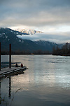 Idaho, Bonners Ferry. Enjoying the Kootenai River flowing in the fall with snow on the Selkirk mountains