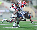 Georgia tight end Orson Charles (7) is tackled by Ole Miss' Charles Sawyer (3) at Vaught-Hemingway Stadium in Oxford, Miss. on Saturday, September 24, 2011. Georgia won 27-13.