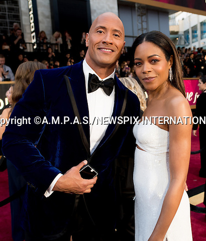 26.02.2017; Hollywood, USA: DWAYNE JOHNSON and NAOMIE HARRIS<br /> attends The 89th Annual Academy Awards at the Dolby&reg; Theatre in Hollywood.<br /> Mandatory Photo Credit: &copy;AMPAS/NEWSPIX INTERNATIONAL<br /> <br /> IMMEDIATE CONFIRMATION OF USAGE REQUIRED:<br /> Newspix International, 31 Chinnery Hill, Bishop's Stortford, ENGLAND CM23 3PS<br /> Tel:+441279 324672  ; Fax: +441279656877<br /> Mobile:  07775681153<br /> e-mail: info@newspixinternational.co.uk<br /> Usage Implies Acceptance of Our Terms &amp; Conditions<br /> Please refer to usage terms. All Fees Payable To Newspix International