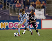 Colorado Rapids midfielder Wells Thompson (15) moves down the wing as New England Revolution midfielder Sainey Nyassi (14) pressures. The Colorado Rapids defeated the New England Revolution, 2-1, at Gillette Stadium on April 24, 2010.