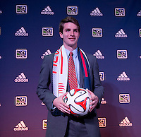 #11 overall pick Patrick Mullins of the New England Revolution stands on the podium during the MLS SuperDraft at the Pennsylvania Convention Center in Philadelphia, PA, on January 16, 2014.