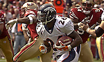 Denver Broncos running back Clinton Portis (26) makes a good run on Sunday, September 15, 2002, in San Francisco, California. The Broncos defeated the 49ers 24-14.