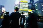 Japan, Tokyo, Shinjuku, businessmen on street (blurred motion)