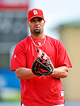 3 March 2011: St. Louis Cardinals' first baseman Albert Pujols warms up prior to a Spring Training game against the Washington Nationals at Roger Dean Stadium in Jupiter, Florida. The Cardinals defeated the Nationals 7-5 in Grapefruit League action. Mandatory Credit: Ed Wolfstein Photo