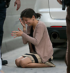 A distraught Pamela Rauseo, 37, reacts after performing CPR on her nephew, five-month-old Sebastian de la Cruz, who stopped breathing. She performed CPR after pulling her SUV over on the side of the road along the west bound lane on Florida state road 836 just east of 57th Avenue around 2:30pm on Thursday, February 20, 2014.