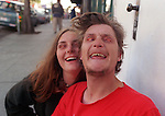 Farmboy and Krisy turn their eyelids inside out to get attention for share change business at Haight and Ashbury in San Francisco