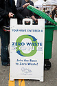 People Dumping Rubbish by a Zero Waste Zone Sign at Ecology Center's Berkeley Farmers' Market which prides itself on being a 'Zero Waste Zone' and prohibiting genetically modified foods. Berkeley, California, USA