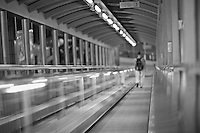 Riding down the Central-Mid-Levels escalator in Hong Kong, before 7am; the escalator system is over 800m long and was constructed in 1993