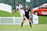 Demitry Imbongo (92) of the New England Revolution goes against Conor Shanosky (17) of D.C. United. D.C. United defeated the The New England Revolution 3-1 in the Quarterfinals of Lamar Hunt U.S. Open Cup, at the Maryland SoccerPlex, Tuesday June 26 , 2013.
