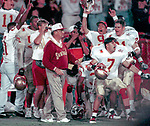 Florida State players erupt in celebration as Bobby Bowden watches as his placekicker puts a second kick through the uprights in the closing seconds of the 1994 Orange Bowl in Miami to defeat the Nebraska Cornhuskers for the 1993 National Championship. (Mark Wallheiser/TallahasseeStock.com)