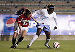 Maryland's Amanda Paizs (20) pulls on the jersey of UNC's Jaime Gilbert (5) on Wednesday, November 2nd, 2005 at SAS Stadium in Cary, North Carolina. The University of North Carolina Tarheels defeated the University of Maryland Terrapins 3-1 during their Atlantic Coast Conference Tournament Quarterfinal game.