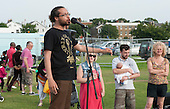 """Dean Atta, poet, (www.deanatta.co.uk) at """"Showtime"""", part of the London 2012 Festival of Arts to celebrate the London Olympics.  A family fun spectacle including dance, painting, music, acrobatics and some large mobile dynosaurs walking amongst the crowd.  On Blackheath Common, Saturday August 4th and funded by the Mayor of London and Arts Council England."""