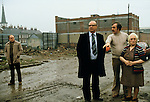 GERRY FITT WITH ALEC DOUGLAS ( his body guard) AND CONSTITUANTS UNITY FLATS BELFAST, Sir Gerry Fitt, founder of the SLDP and MP for West Belfast,