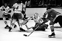 Seals Gilles Meloche defends against the Chicago Black Hawks, #4 Bob Stewart. (1975 photo/Ron Riesterer)