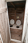 Two holer, weathered, white wooden outhouse at the historic Czech hall ACBJ-WFLA example of Bohemian architecture..Rad Slavin No. 112