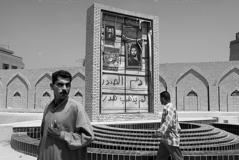 Baghdad, Iraq, April 14, 2003.A new unfinished fountain in front of the Al Khaddamein mosq, was featuring a monumental portrait of Saddam; it has been replaced in the last couple of days by pictures of Imam Ali and Imam Hussein.