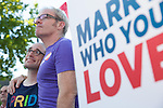 William Hamilton and Ben Gertzfield, above left to right, of Santa Clara listen to speakers at a rally at the Mountain View City Hall June 27. The couple has been engaged for four years, and the Supreme Court's decision to overturn Proposition 8 opens the door for the issuance of marriage licenses in California.