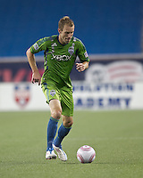 Seattle Sounders defender Tyson Wahl (5) dribbles. In a Major League Soccer (MLS) match, the Seattle Sounders FC defeated the New England Revolution, 2-1, at Gillette Stadium on October 1, 2011.