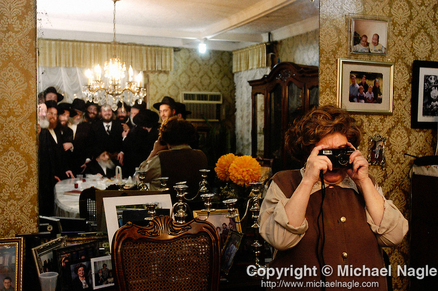 BROOKLYN  --  NOVEMBER 13, 2004:  Scaindel Schneerson takes a picture during her father Rabbi Yehuda Chitrik's 105th birthday party on November 13, 2004 in Brooklyn.  (PHOTOGRAPH BY MICHAEL NAGLE)