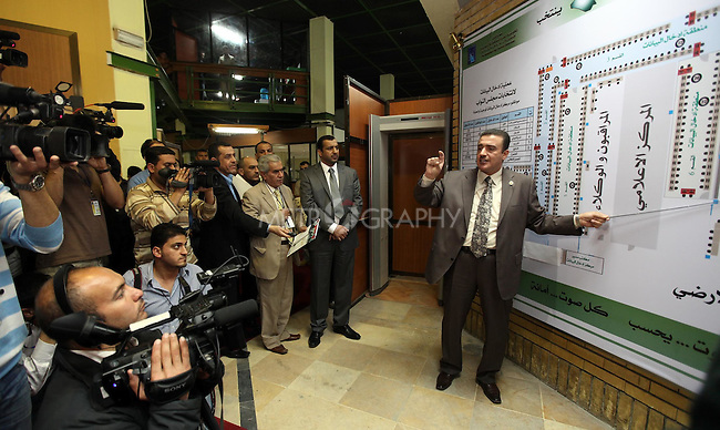 BAGHDAD, IRAQ: A employee of the Independent High Electoral Commission (IHEC) explains to the media how the votes in the upcoming Iraqi elections will be counted...Photo by Ceerwan Aziz/Metrography