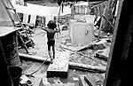 Criança em favela, bairro pobre na cidade Afogados Ingazeiro, lugar onde a maioria das famílias vieram de áreas rural - Seca no nordeste brasileiro / Pernambuco..Child in slum, poor neighborhood in the city Drowned Ingazeiro, place where most of the families came from rural areas - it Dries in the Brazilian northeast / Pernambuco.
