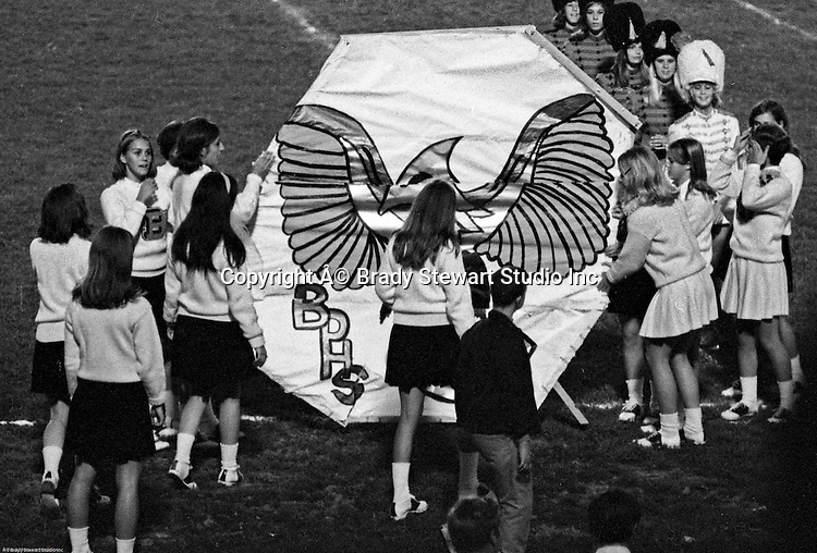Bethel Park PA:  Bethel Park Cheerleaders and Majorettes preparing a sign for the football players to run through.  Patrick Stewart is supervising the activity - 1969.  Others in the photo; Patsy Koeber, Pat Stewart, Paige Keenan, Laurie Peters